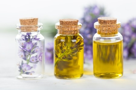 43157468 - lavender flowers with essential oil, close-up.